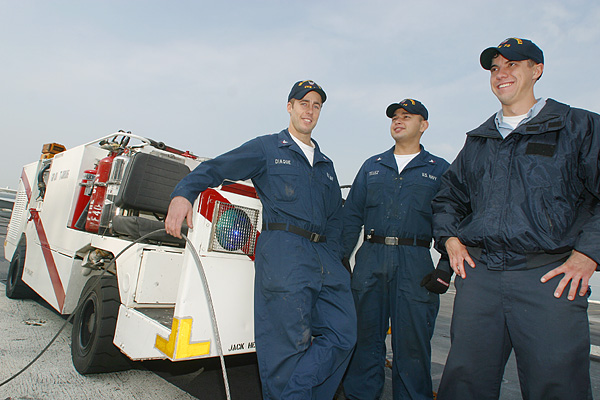 Proud US carrier crew with their mini fire truck