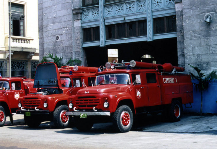 Zils outside Fire Station at Havana, Cuba