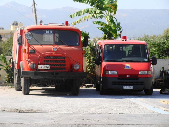 Two vehicles outside Fire station city of Kos